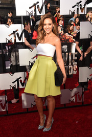 Jessica Alba added a '50s vibe with a flared yellow skirt by Kenzo.