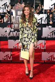 Zendaya Coleman showed off her svelte figure in a body-con rose-print dress by Emanuel Ungaro, featuring an ultra-high slit, during the MTV Movie Awards.