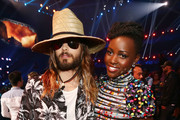 Actor Jared Leto (L) and actress Lupita Nyong'o attend the 2014 MTV Movie Awards at Nokia Theatre L.A. Live on April 13, 2014 in Los Angeles, California.