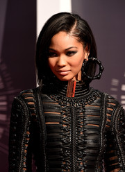 Chanel Iman looked majorly edgy at the MTV VMAs with her massive black hoops teamed with a fierce LBD.