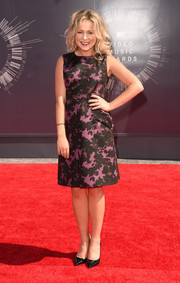 TV host Poppy Jamie looked ladylike in a purple and black, knee-length Burberry dress.