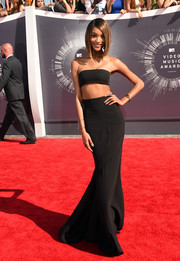 Model Jourdan Dunn wore a black Balmain maxi skirt and bralette top.