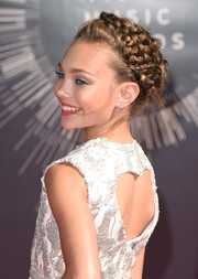 Maddie Ziegler complemented her sparkling dress with a pair of diamond studs.