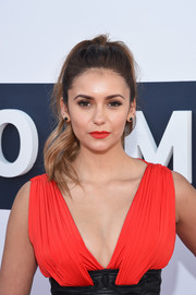Nina Dobrev's lips echoed the sexy red of her dress.