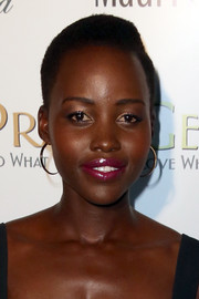 Lupita Nyong'o finished off her look with a pair of classic gold hoops.