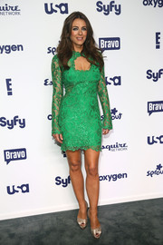 Elizabeth Hurley looked as sexy as ever at the NBCUniversal Cable Entertainment Upfronts in a green lace mini with a cleavage-baring cutout.