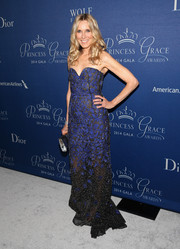 Alana Stewart looked ageless at the Princess Grace Awards Gala in a sheer black strapless gown with purple embellishments.