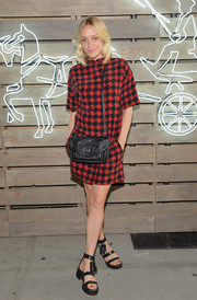 Chloe Sevigny donned a red and black houndstooth mini by Coach for the Summer Party.