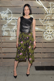 Eva Chen showed off her edgy summer style with a pair of tropical-print culottes teamed with a leather top during the Coach Summer Party.