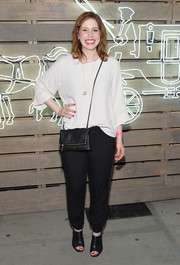 A pair of black open-toe booties finished off Vanessa Bayer's look in tough-chic style.