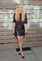 Riley Keough rocked leather in summer with this black mini skirt.