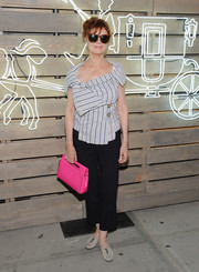 A neon-pink leather purse added a fun pop of color to Susan Sarandon's ensemble.