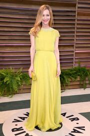 Leslie Mann was a burst of sunshine in a yellow gown by Jenny Packham during the Vanity Fair Oscar party.