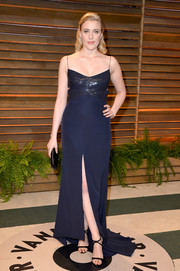 Greta Gerwig was all about simple elegance in a navy spaghetti-strap evening dress by Narciso Rodriguez during the Vanity Fair Oscar party.
