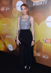 An oversized black satin clutch infused some elegance into Skylar Grey's edgy outfit.