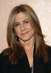Jennifer Aniston sported a sleek center-parted layered cut at the New York screening of 'Cake.'