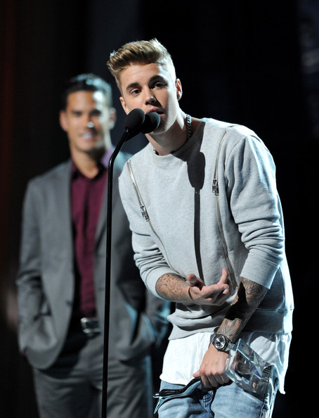 Justin Bieber teamed his outfit with a stylish titanium quartz watch for the 2014 Young Hollywood Awards.