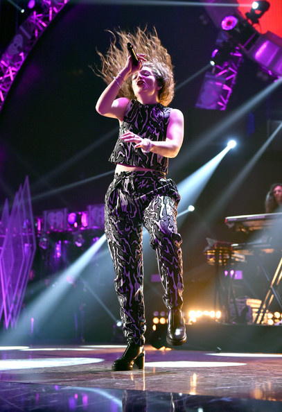 Lorde wore a sleeveless camo crop-top while performing at the 2014 iHeartRadio Music Festival.