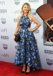 Rebecca Gayheart paired her lovely dress with a beaded black satin clutch.