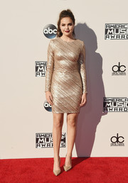Bailee Madison shimmered on the American Music Awards red carpet in a gold sequin dress by House of CB.