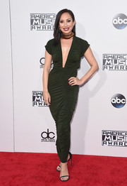 Cheryl Burke worked a curvy look in a ruched green evening dress during the American Music Awards.