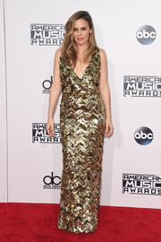 Alicia Silverstone made an appearance at the American Music Awards looking oh-so-glam in a gold paillette gown by Christian Siriano.