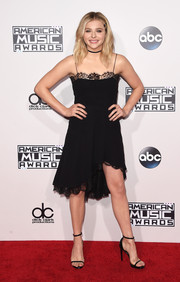 Chloe Grace Moretz went for girly allure in a lace-detail slip dress by Saint Laurent at the American Music Awards.