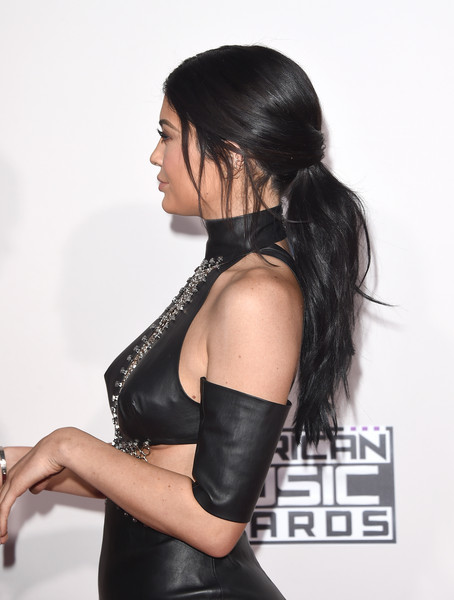 More Pics of Kylie Jenner Loose Ponytail (1 of 44) - Kylie Jenner Lookbook - StyleBistro [hair,shoulder,lady,black hair,hairstyle,beauty,joint,arm,latex clothing,photo shoot,arrivals,kylie jenner,american music awards,microsoft theater,los angeles,california]