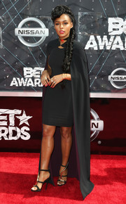 The caped look is fast becoming Janelle Monae's signature. For the BET Awards, she donned this floor-length SAFiYAA number over a matching LBD.
