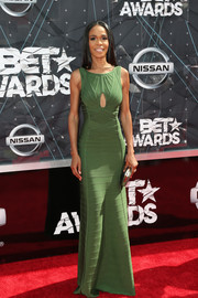Michelle Williams chose a green cutout bandage gown by Herve Leger for her BET Awards red carpet look.