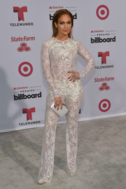 For her Billboard Latin Music Awards look, Jennifer Lopez chose a sheer white lace jumpsuit by Zuhair Murad.