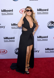 Mariah Carey brought plenty of sizzle to the Billboard Music Awards red carpet with this black Tom Ford fishtail dress, with its asset-baring neckline and side cutouts.
