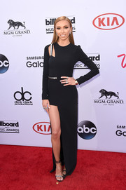Giuliana Rancic went for ultra-modern edge at the Billboard Music Awards in an asymmetrical black Mugler gown with metal embellishments.