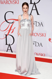 Coco Rocha was sweet and glam at the CFDA Fashion Awards in a pearl-gray Banana Republic gown with a bowed neckline and a banded waist.