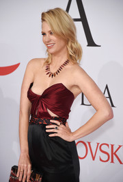 January Jones' gemstone rings were a perfect complement to her jumpsuit at the 2015 CFDA Fashion Awards.