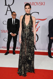 Hilary Rhoda put plenty of skin on display in this sheer, plunging J. Mendel halter gown at the CFDA Fashion Awards.