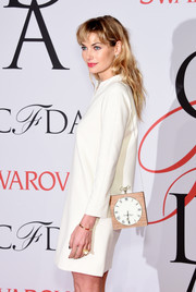 Jessica Hart went for quirky styling with this clock bag at the CFDA Fashion Awards.