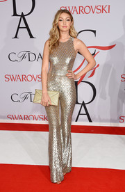 Gigi Hadid worked a fun and flirty '70s vibe in a sequined gold Michael Kors jumpsuit during the CFDA Fashion Awards.