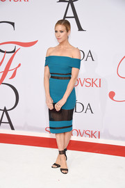 Brittany Snow went for subtle sexiness at the CFDA Fashion Awards in a teal Rachel Roy off-the-shoulder dress with sheer black inserts.
