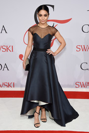 Vanessa Hudgens looked breathtakingly elegant at the CFDA Fashion Awards in a midnight-blue Sachin & Babi Noir gown with a sheer yoke and a high-low hem.