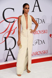 Joan Smalls took a super-sexy plunge at the CFDA Fashion Awards in a white Calvin Klein zipper-front dress with a down-to-the-navel neckline.
