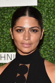 Camila Alves styled her hair into a sleek center-parted ponytail for the 2015 Couture Council luncheon.
