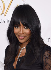 Naomi Campbell styled her look with a stunning diamond Y-drop necklace.