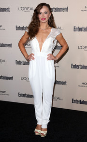 Karina Smirnoff chose a vintage white jumpsuit with a plunging neckline and lace shoulders for her Entertainment Weekly pre-Emmy party look.