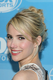 Emma Roberts attended the Fox Programming Presentation looking edgy-glam with her knotted updo.
