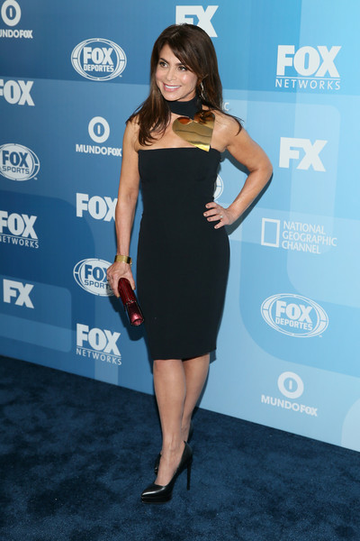 Paula Abdul sheathed her petite figure in a tight-fitting LBD with a metal heart-embellished neckline for the Fox Programming Presentation.