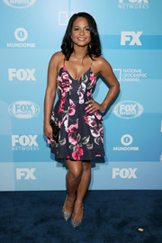 Christina Milian was in the mood for print, pairing her floral dress with a pair of black-and-white grid-patterned pumps.