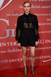 Black Jimmy Choo gladiator heels finished off Diane Kruger's look in fierce style.