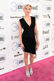 Scarlett Johansson cut a sexy silhouette in a low-cut, asymmetrical-hem peplum LBD by Bec & Bridge during the Film Independent Spirit Awards.