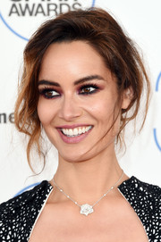 Berenice Marlohe worked a messy-sexy updo during the Film Independent Spirit Awards.